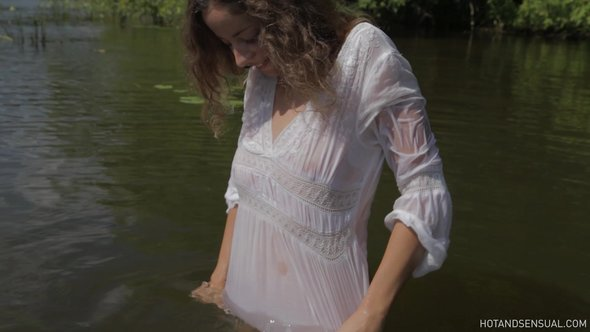 Sexy girl flirts bathing in wet see through blouse